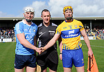 captains Liam Rushe of Dublin and Cian Dillon of Clare with referee Alan Kelly before their National Hurling League game at Cusack Park. Photograph by John Kelly.