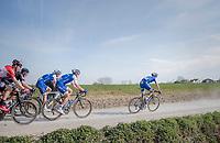 peloton led by Zdenek Stybar (CZE/Quick Step Floors) racing over the newly added gravel roads around Ploegsteert, called 'Plugstreets'<br /> <br /> 79th Gent-Wevelgem 2017 (1.UWT)<br /> 1day race: Deinze › Wevelgem - BEL (249km)