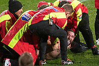 A pitch invader is held down during by Red Badge staff during the 2021 Super Rugby Aotearoa final between the Crusaders and Chiefs at Orangetheory Stadium in Christchurch, New Zealand on Saturday, 8 May 2021. Photo: Joe Johnson / lintottphoto.co.nz