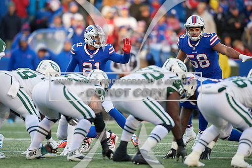 Buffalo Bills Jordan Poyer (21) and Matt Milano (58) on defense during an NFL football game against the New York Jets, Sunday, December 9, 2018, in Orchard Park, N.Y.  (Mike Janes Photography)