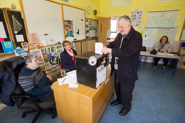 Local man John Joe Barry (82), a returned emigrant casting his vote for his very first time in Ireland watched by Stephen Mulvihill, Poll Clerk, and Delia Mc Grath, Presiding Officer, at the Scoil Realt na Mara polling station in Kilkee. Photograph by John Kelly.