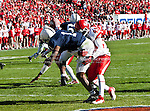 Penn State Nittany Lions quarterback Rob Bolden (1)and Houston Cougars linebacker Derrick Mathews (49) in action during the Ticket City Bowl game between the Penn State Nittany Lions and the University of Houston Cougars, played at the Cotton Bowl Stadium in Dallas, Texas. Houston defeats Penn State 30 to 14.