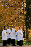 Clergymen wait to process into the chapel on the campus of Belmont Abbey in Belmont, NC.