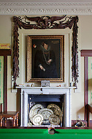 A formidable portrait of Ursula, Lady Scudamore dating from the late 16th century, hangs in the library and billiard room, framed by Grinling Gibbons carvings