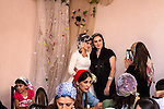 Guests take pictures with the bride at a wedding ceremony. Argun, Chechnya, Russia, 2012