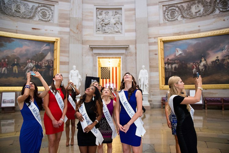 UNITED STATES - SEPTEMBER 2: Miss America pageant contestants look up at the ceiling of the rotunda during their tour of the U.S. Capitol on September 2, 2014. (Photo By Bill Clark/CQ Roll Call)