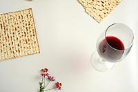 Jewish passover matzoh wine and flowers