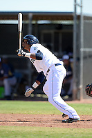 Seattle Mariners outfielder Hersin Martinez (12) during an Instructional League game against the Milwaukee Brewers on October 4, 2014 at Peoria Stadium Training Complex in Peoria, Arizona.  (Mike Janes/Four Seam Images)