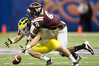 Detrick Bonner of Virginia Tech knocks the ball away from Drew Dileo of Michigan during Sugar Bowl game at Mercedes-Benz SuperDome in New Orleans, Louisiana on January 3rd, 2012.  Michigan defeated Virginia Tech, 23-20 in first overtime.