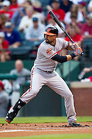 Baltimore Orioles outfielder Nick Markakis #21 at bat during the Major League Baseball game against the Texas Rangers on August 21st, 2012 at the Rangers Ballpark in Arlington, Texas. The Orioles defeated the Rangers 5-3. (Andrew Woolley/Four Seam Images).
