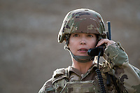 Solo portrait of a US Military woman photographed in natural light.