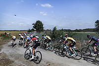 peloton riding a gravel section<br /> <br /> Antwerp Port Epic 2020 <br /> One Day Race: Antwerp to Antwerp 183km; of which 28km are cobbles and 35km is gravel/off-road<br /> Bingoal Cycling Cup 2020
