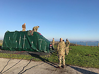 Pictured: RAF crew help unload a fire engine to Caldey Island off the Pembrokeshire coast, Wales, UK. Tuesday 24 January 2017<br /> Re: A Fire and Rescue Appliance has been delivered to Caldey Island via Chinook Helicopter. <br /> Mid and West Wales Fire and Rescue Service and the RAF have flown a Rural Response Pump to Caldey Island.<br /> The island, off Tenby in Pembrokeshire is inhabited by Cistercian Monks