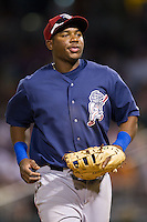 Lehigh Valley IronPigs first baseman Maikel Franco (10) jogs off the field between innings of the International League game against the Charlotte Knights at BB&T Ballpark on May 8, 2014 in Charlotte, North Carolina.  The IronPigs defeated the Knights 8-6.  (Brian Westerholt/Four Seam Images)