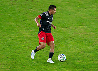 WASHINGTON, DC - NOVEMBER 8: Edison Flores #10 of D.C. United dribbles during a game between Montreal Impact and D.C. United at Audi Field on November 8, 2020 in Washington, DC.