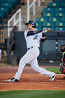 Jackson Generals catcher Oscar Hernandez (28) follows through on a swing during a game against the Chattanooga Lookouts on April 27, 2017 at The Ballpark at Jackson in Jackson, Tennessee.  Chattanooga defeated Jackson 5-4.  (Mike Janes/Four Seam Images)