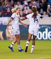 HOUSTON, TX - JANUARY 31: Lindsey Horan #9 and Jess McDonald #14 of the United States celebrate during a game between Panama and USWNT at BBVA Stadium on January 31, 2020 in Houston, Texas.