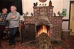 Burning the Ashen Faggot old New Years Eve. 6 January 2020. The Squirrel Inn Laymore Dorset, UK . Similar to  a Christmas Yule log thats burnt on Christmas Eve and put whole into the hearth of a fireplace. In Laymore the Ashen Faggot is approximately 15 feet long and bound in 12 sections with twelve green lengths of hazel bands or 'beams' one section representing each day after Christmas.