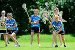 BERLIN, GERMANY - JUNE 22: Placementgame for 9th-12th between Swiss National Team (light blue) vs Helsinki Chiefettes (gold) during the Berlin Open Lacrosse Tournament 2013 at Stadion Lichterfelde on June 22, 2013 in Berlin, Germany. Final score 8-4. (Photo by Dirk Markgraf/www.265-images.com)