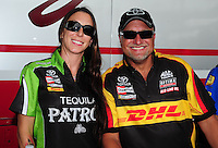 Jun. 30, 2012; Joliet, IL, USA: NHRA funny car driver Alexis DeJoria (left) with Jeff teammate Arend during qualifying for the Route 66 Nationals at Route 66 Raceway. Mandatory Credit: Mark J. Rebilas-