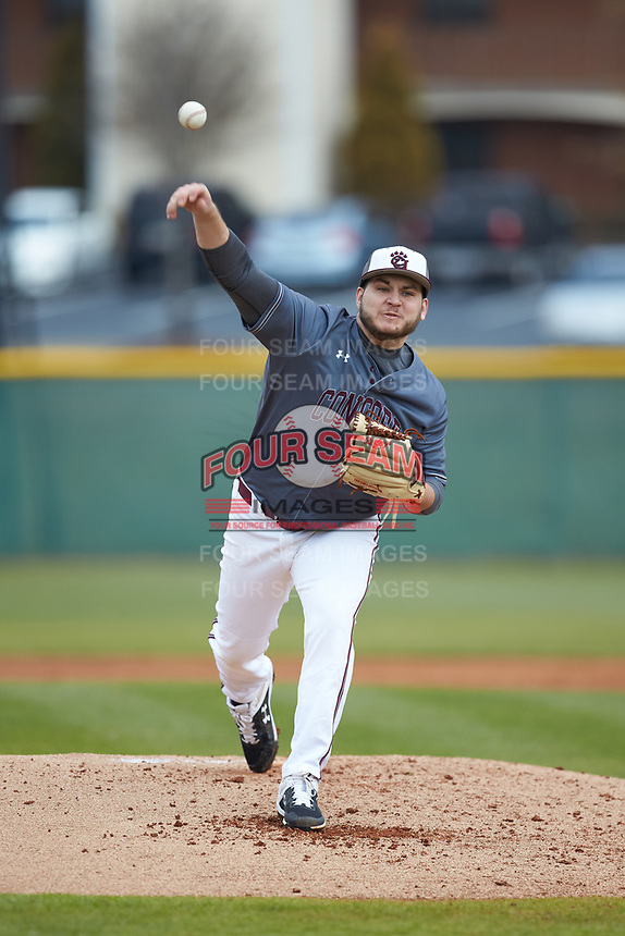 Concord Mountain Lions starting pitcher Trent Abernathy (27) delivers a pitch to the plate against the Wingate Bulldogs at Ron Christopher Stadium on February 1, 2020 in Wingate, North Carolina. The Bulldogs defeated the Mountain Lions 8-0 in game one of a doubleheader. (Brian Westerholt/Four Seam Images)