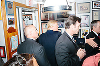 Republican presidential candidate Donald Trump leaves the Red Arrow Diner in Manchester, New Hampshire.