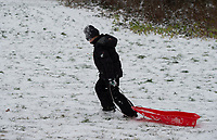 A young boy sledging in the park in Sidcup following Heavy Snowfall at Sidcup, Kent, England on the 8 February 2021. Photo by Alan Stanford.