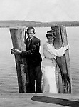 Lakewood NY: Young woman and Clark Stewart waiting for the City of Cleveland Ferry on the Kent House Pier. Photographs taken during a church field trip to Chautauqua Institution in New York (Lake Chautauqua). The Stewart family and friends visited Chautauqua during 1901 to hear Stewart relative, Dr. S.H. Clark  speak at the institute. Alice Brady Stewart chaperoned and Brady Stewart came along to photograph the trip.  The Gallery provides a glimpse of how the privileged and church faithful spent summers at Lake Chautauqua at the turn of the century.