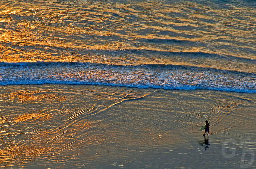 Surfer at sunset Kuta Beach, Legian Bali,aerial view,