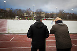Turkiyemspor Berlin 3 BSC Rehberge 0, 22/11/2015. Willy-Kressmann-Stadion, Berlin Landesliga. Two spectators watching the second-half at Willy-Kressmann-Stadion as Turkiyemspor Berlin (red) play BSC Rehberge in a Berlin Landesliga fixture which they won 3-0. The club was formed in 1978 to represent members of Berlin's large Turkish community and achieved several promotions and local cup wins throughout the first 15 years of their existence. Since then, financial problems have led to successive relegations and they now find themselves in the city's second division. Photo by Colin McPherson.