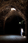 A visitor stares up from a walkway beneath the Bosra Amphitheatre one of the best preserved Roman theatre's in existence located 145 kilometres south of Damascus.