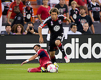 Gonzalo Segares (13) of the Chicago Fire tackles the ball away from Nick DeLeon (18) of D.C. United during a Major League Soccer game at RFK Stadium in Washington, DC.  The Chicago Fire defeated D.C. United, 3-0.
