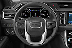 Car pictures of steering wheel view of a 2021 GMC Yukon-XL Denali 5 Door SUV Steering Wheel