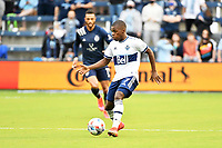 KANSAS CITY, KS - MAY 16: Deiber Caicedo #7 Vancouver Whitecaps with the ball during a game between Vancouver Whitecaps and Sporting Kansas City at Children's Mercy Park on May 16, 2021 in Kansas City, Kansas.