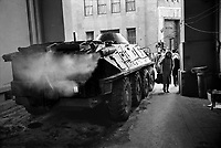 ROMANIA, Calea Victoriei, Bucharest, 23.12.1989<br /> People rise against Ceausescu. The dictator has fled the city on dec. 22. Soldiers guarding the telecommunication building taking cover from incoming fire, probably by Securitate and other interior troops. BTR-80 armoured personnel carrier. <br /> © Andrei Pandele / EST&OST