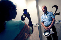 (Oslo July 26, 2011)  Police Officer Erik Andersen is photographed by a girl during a visit to the World Islamic Mission in Oslo, following terrorist attacks...A large vehicle bomb was detonated near the offices of Norwegian Prime Minister Jens Stoltenberg on 22 July 2011. .Another terrorist attack took place shortly afterwards, where a man killed 68 people, mainly children and youths attending a political camp at Utøya island. ..Anders Behring Breivik was arrested on the island and has admitted to carrying out both attacks..(photo:Fredrik Naumann/Felix Features)