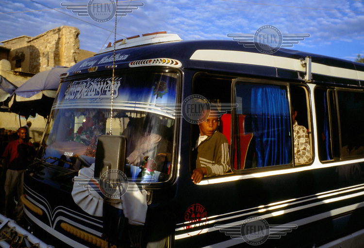 A boy sits aboard a decorated bus in the capital. Buses in Somaliland connect all parts of the country.