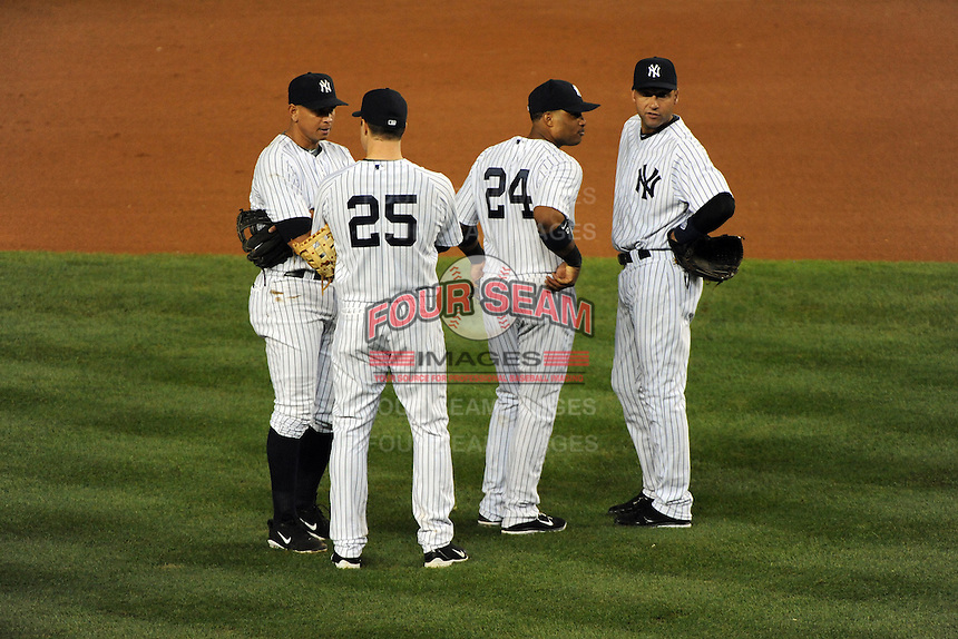 New York Yankees 3rd baseman Alex Rodriguez #13, 1st baseman Mark Teixerira #25, 2nd baseman Robinson Cano #24, and shortstop Derek Jeter #2 during ALDS game #5 against the Detroit Tigers at Yankee Stadium on October 06, 2011 in Bronx, NY.  Detroit defeated New York 3-2 to take the series 3 games to 2 games.  Tomasso DeRosa/Four Seam Images