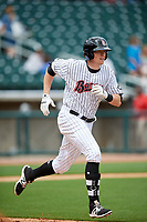 Birmingham Barons left fielder Cameron Seitzer (33) runs to first base during a game against the Jacksonville Jumbo Shrimp on April 24, 2017 at Regions Field in Birmingham, Alabama.  Jacksonville defeated Birmingham 4-1.  (Mike Janes/Four Seam Images)