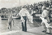1978<br />  FILE PHOTO - ARCHIVES -<br /> <br /> Crowds cheer John Kinsella as he walks ashore after swimming Lake Ontario in record time of 13 hours, 49 minutes<br /> <br /> Bezant, Graham<br /> Picture, 1978<br /> <br /> 1978<br /> <br /> PHOTO : Graham Bezant - Toronto Star Archives - AQP