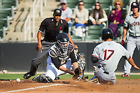 Kannapolis Intimidators catcher Jeremy Dowdy (25) can't handle the throw as Evan Van Hoosier (17) of the Hickory Crawdads slides into home plate as umpire Erich Bacchus looks on at CMC-Northeast Stadium on May 18, 2014 in Kannapolis, North Carolina.  The Intimidators defeated the Crawdads 6-5 in 10 innings.  (Brian Westerholt/Four Seam Images)
