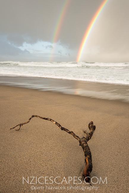 Dawn on beach at Kohaihai near Karamea with rainbow, West Coast, Buller Region, Kahurangi National Park, New Zealand
