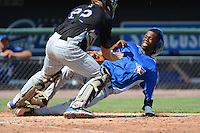 Shortstop Henry Davis (17) of Mayo High Math Science Tech High School in Darlington, South Carolina for the Toronto Blue Jays scout team slides into home past Jeffrey Shwarz (22) during the East Coast Pro Showcase on August 2, 2013 at NBT Bank Stadium in Syracuse, New York.  (Mike Janes/Four Seam Images)