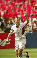 Clint Mathis celebrates his goal. The USA tied South Korea, 1-1, during the FIFA World Cup 2002 in Daegu, Korea.