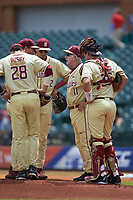 Florida State Seminoles head coach Mike Martin Sr. (11) has a meeting on the mound during the game against the North Carolina Tar Heels in the 2017 ACC Baseball Championship Game at Louisville Slugger Field on May 28, 2017 in Louisville, Kentucky. The Seminoles defeated the Tar Heels 7-3. (Brian Westerholt/Four Seam Images)