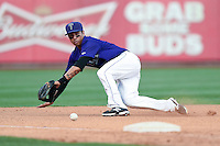 Tulsa Drillers third baseman Joey Wong (1) makes a diving stop during the second game of a doubleheader against the Frisco Rough Riders on May 29, 2014 at ONEOK Field in Tulsa, Oklahoma.  Frisco defeated Tulsa 3-2.  (Mike Janes/Four Seam Images)