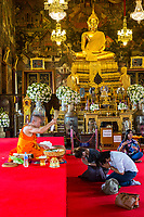 Bangkok, Thailand.  A Couple Receives a Blessing by a Buddhist Monk in the Ubosot of the Wat Arun Temple.