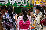 July 13, 2014, Tokyo, Japan - Visitors enjoy eating during the annual Mitama festival at Yasukuni Shrine on July 13, 2014. The festival celebrates the spirits of lost ancestors and is held across Japan in early July. There are over 30,000 lanterns lining the path to the shrine to help spirits find their way during the festival. Yasukuni Shrine is also the place where more than 2.4 million war dead are enshrined.This year the festival is held from July 13 to 16. (Photo by Rodrigo Reyes Marin/AFLO)