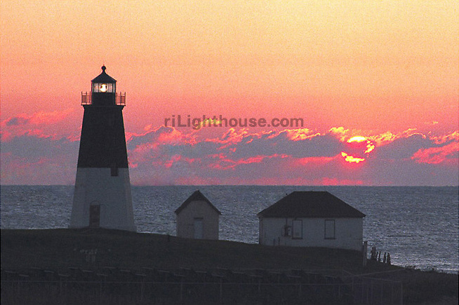 The setting sun illuminate the horizon at Point Judith Light