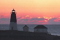 The setting sun illuminate the horizon at Point Judith Light